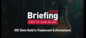 Graphic with episode title: IOC Gets Gold In Trademark Enforcement